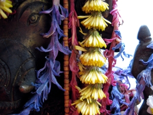 Ganesha and flower mala