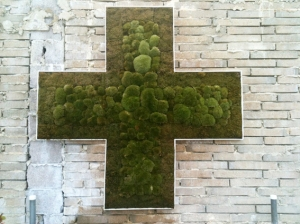 Moss Cross on wall above stage