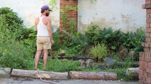 Jared watering pool garden