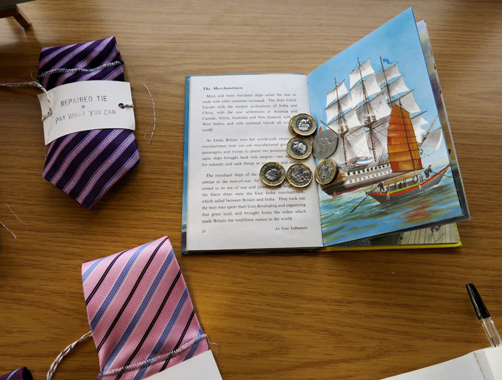 Ladybird book with money and repaired ties